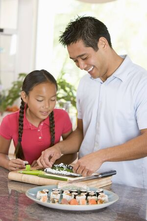 11 year old: Father And Daughter Preparing Sushi Together  Stock Photo