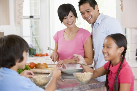 Family In Kitchen Eating Breakfast photo