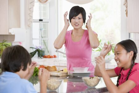 food fight: Children Play Fight While Having Breakfast Stock Photo