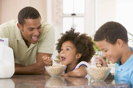 mom and dad: Children Eating Breakfast With Dad