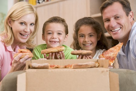 6 7 year old: Family Eating Pizza Together  Stock Photo