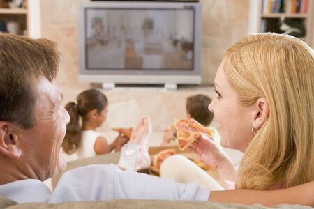 6 7 year old: Couple Enjoying Pizza In Front Of TV