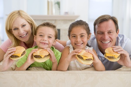 6 7 year old: Family Eating Cheeseburgers Together