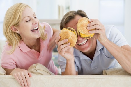 Couple Enjoying Burgers Together Stock Photo - 4445480