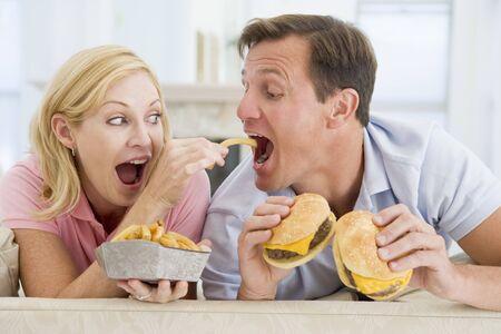 Couple Enjoying Burgers Together photo