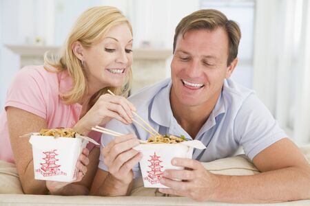 mealtime: Couple Eating Takeaway meal,mealtime Together
