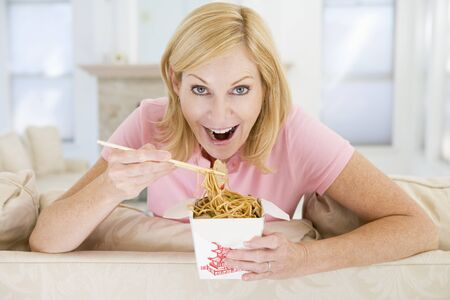 Woman Eating meal,mealtime With Chopsticks  photo