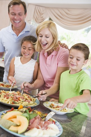 Mother Serving Up Dinner For Family photo