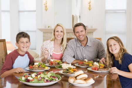 9 year old: Family Enjoying meal,mealtime Together Stock Photo