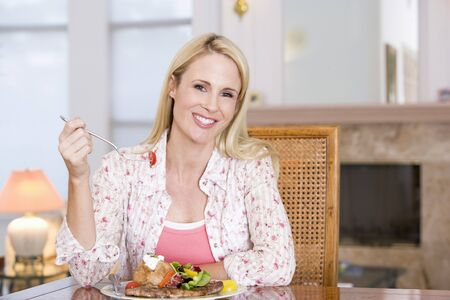 mealtime: Woman Enjoying Healthy meal,mealtime Stock Photo