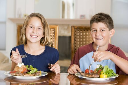 Brother And Sister Eating meal,mealtime Together  Stock Photo - 4446310