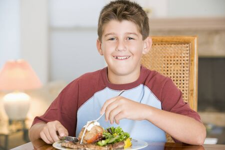 9 year old: Young Boy Eating meal,mealtime