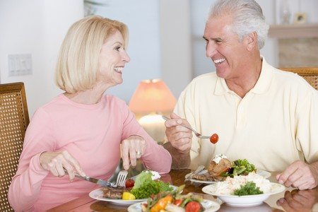 Elderly Couple Enjoying Healthy meal,mealtime Together photo