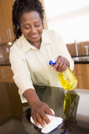 wiping: Woman Cleaning Kitchen Counter Stock Photo