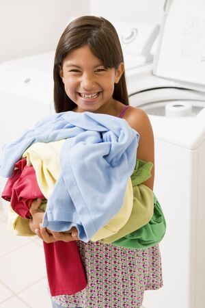 laundry room: Young Girl Doing Laundry