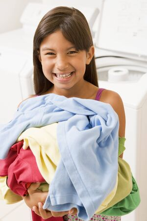 Young Girl Doing Laundry photo