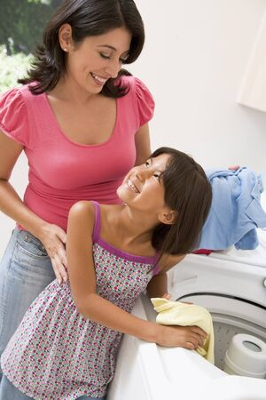 Mother And Daughter Doing Laundry Stock Photo - 4446438