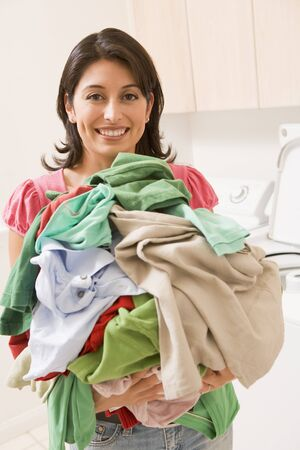 Woman Holding Pile Of Laundry photo