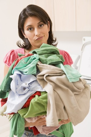 laundry: Woman Holding Pile Of Laundry Stock Photo