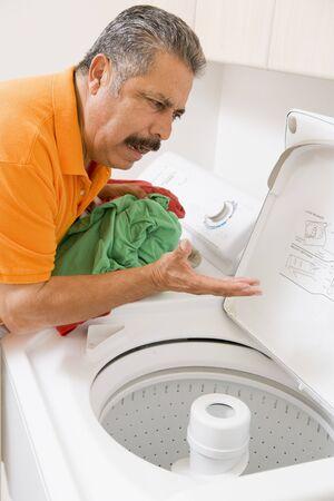 Man Doing Laundry photo
