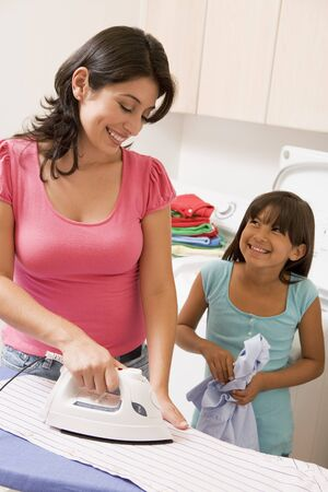domestic chore: Mother And Daughter Ironing