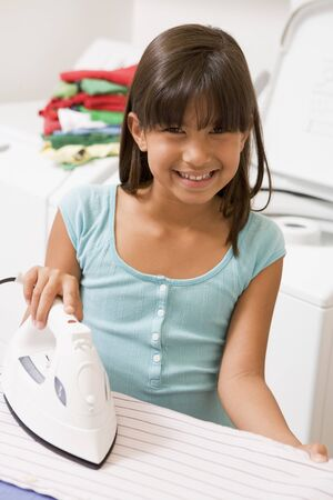 Young Girl Ironing Stock Photo - 4444944