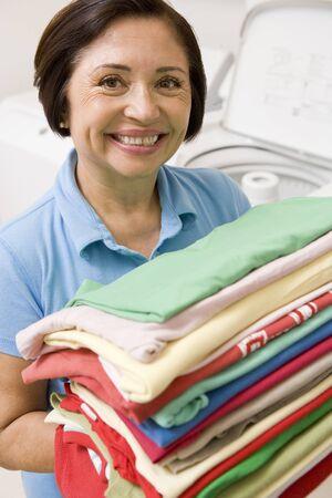 Woman Holding Folded Laundry photo