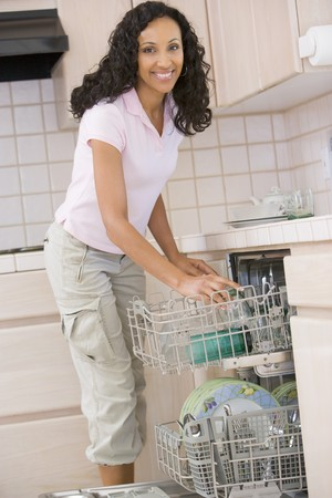 Woman Loading Dishwasher  photo