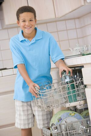 9 year old: Young Boy Loading Dishwasher