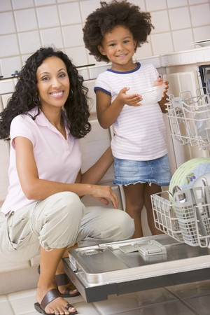 Mother And Daughter Loading Dishwasher photo