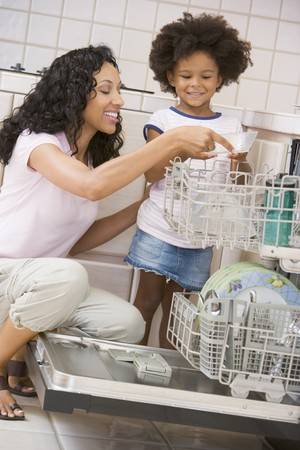 dishwasher: Mother And Daughter Loading Dishwasher Stock Photo
