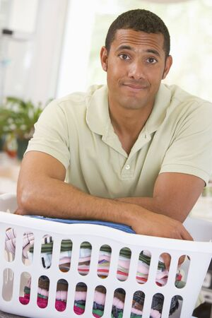 man laundry: Man Leaning On Laundry