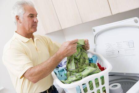 Man Reading Washing Instructions Stock Photo - 4444857