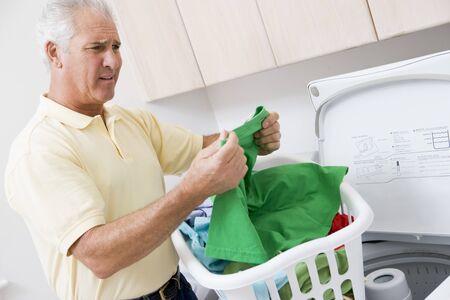 Man Reading Washing Instructions Stock Photo - 4444720