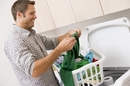 laundry room: Man Doing Laundry  Stock Photo