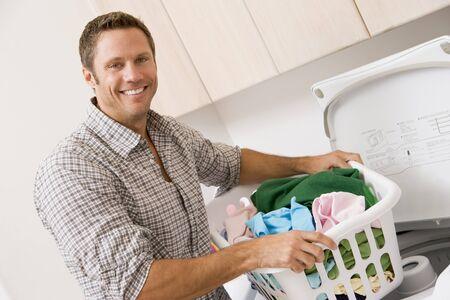 man laundry: Man Doing Laundry  Stock Photo