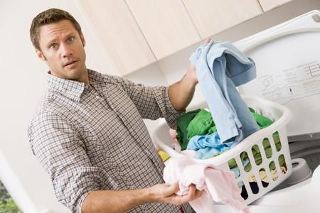 Laundry room: Man Doing Laundry  Stock Photo