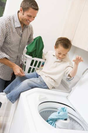 Father And Son Doing Laundry  photo
