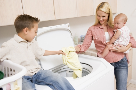 Mother And Children Doing Laundry