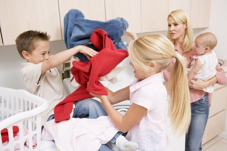 Siblings Fighting While Doing Laundry  photo