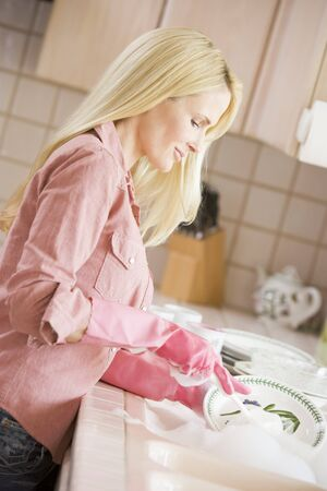 Woman Cleaning Dishes photo