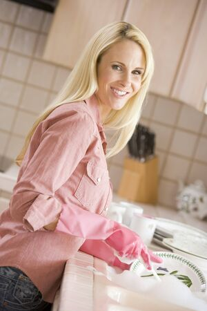 wash dishes: Woman Cleaning Dishes