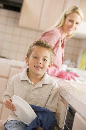 Mother And Son Cleaning Dishes photo