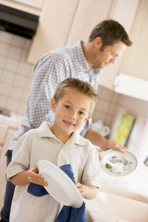 wash dishes: Father And Son Cleaning Dishes