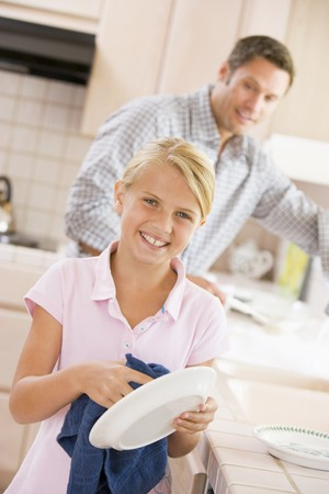 Father And Daughter Cleaning Dishes photo