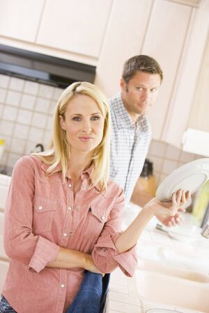 Husband And Wife Doing Dishes photo