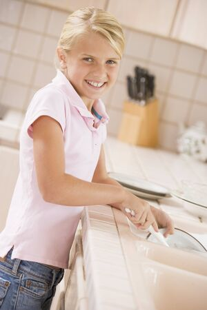 Young Girl Cleaning Dishes,  photo