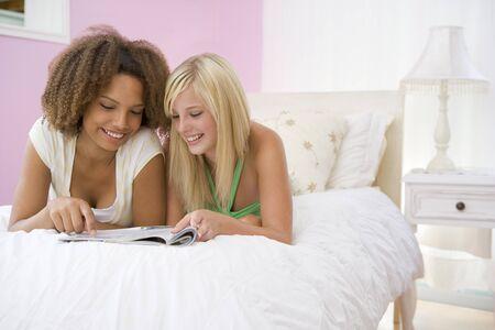 teen girl bedroom: Teenage Girls Lying On Bed