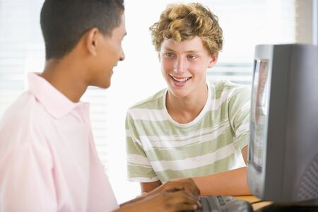 Teenage Boys Using Desktop Computer  Stock Photo - 4444700