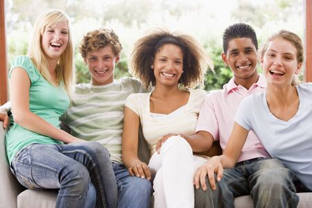 13 year old: Group Of Teenagers Sitting On A Couch Stock Photo